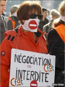 """A demonstrator holds a placard which reads """"banned negotiation"""" during a protest march in Lyon, France"""