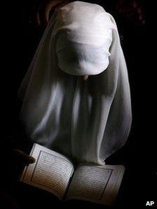 A Muslim woman reads the Koran