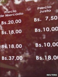 "A menu outside the ""socialist"" Cafe Venezuela displays the cafe's prices (R) as well as the ""capitalist"" prices (L) charged elsewhere"
