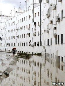 Two people walk along a flooded street in the town of Ecija, southern Spain