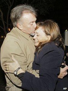 Lt Robert Italiano embracing his daughter