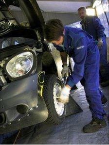 Mechanics working on the Mini rally car