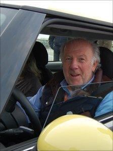 David Richards in an electric Mini