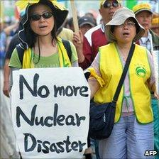 Demonstrators protest against the construction of a local nuclear power plant in in Taipei, Taiwan, on Sunday