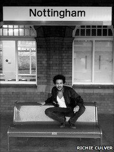 Liam Bailey on a bench at Nottingham Station