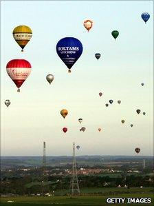 A group of air balloons head for France after taking off from Kent during a world record-breaking attempt for the largest number of hot air balloons to cross the English Channel