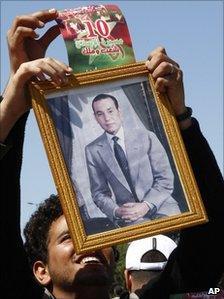 Man holding portrait of King Mohamed VI