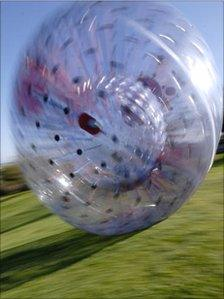 Sphereing, also known as zorbing