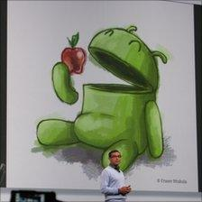 Graphic at the Google IO conference showing the Android logo eating an apple