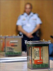 The flight recorders, preserved in a tank of demineralised water, are displayed in Le Bourget, Paris, 12 May