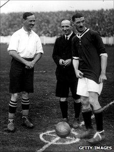 Captains Billy Meredith of Wales (right) and Knight of England toss up before their international match on 11 October, 1919