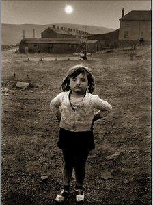 Little girl standing in a playground