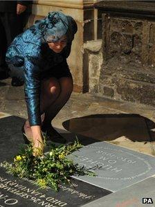 Carol Hughes lays flowers on Ted Hughes's memorial stone