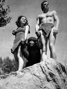 A file photo shows Johnny Weissmuller, right, as Tarzan, Maureen O'Sullivan as Jane, and Cheetah the chimpanzee, in a scene from the 1932 movie Tarzan the Ape Man