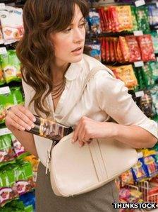 Well-dressed woman shoplifting