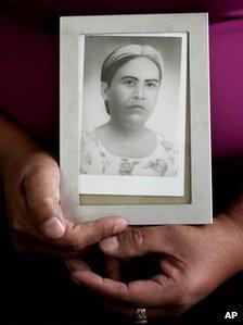 Felicita Romero holds an image of her mother Natividad Ramirez, a victim of the Dos Erres massacre