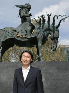 Artist Dashi Namdakov with the statue