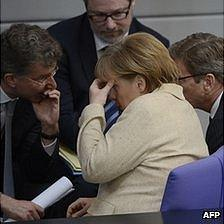 Chancellor Merkel with aides in Bundestag, 10 May 12