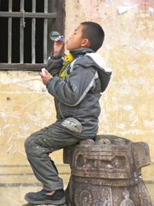 Kid blows bubbles