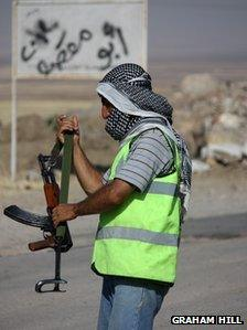 Kurdish militiaman manning a checkpoint in north-west Syria