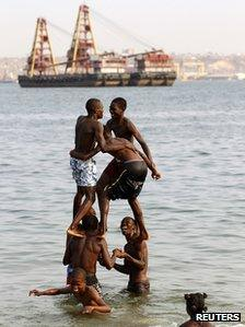 Angolan youths play on the beach in the capital, Luanda 2 September 2012
