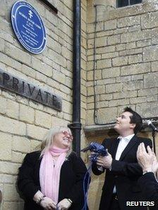 A blue plaque to honour Robin Gibb is unveiled by his widow Dwina (left) and son Robin-John (right), at their home in Thame