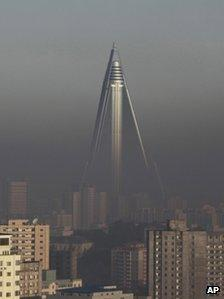 The Ryugyong Hotel stand above the smog dominating the Pyongyang skyline in 2011