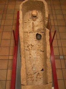 Bath stone coffin containing the skeleton of the Roman man