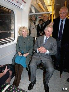 Prince Charles and his wife Camilla, Duchess of Cornwall travel on a Metropolitan underground train