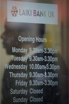 Opening hours advertised at a branch of Laiki Bank