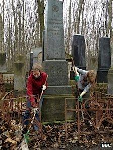 Volunteers clearing up the Jewish cemetery in Warsaw