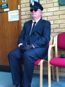 Jon Harvey dressed as a chauffeur