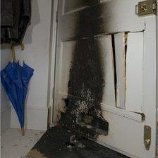 Met Police handout of an arson attack on the home of Martin Rynga
