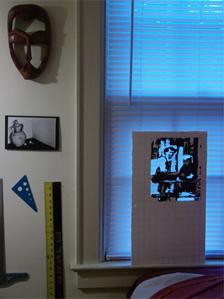 Mike's room with painting on the window sill and wooden mask from Sierra Leone