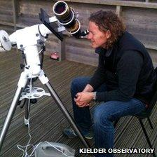 Gary Fildes looking through a telescope