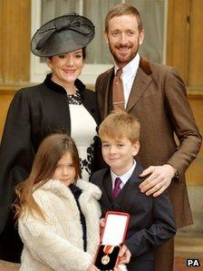 Sir Bradley Wiggins with his wife and children
