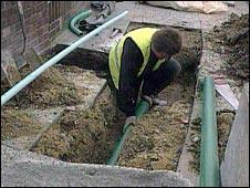 Man digging up road to lay cable
