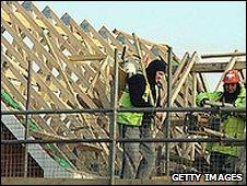 Workers building a house