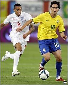 Jermaine Jenas of England chases Brazil's Kaka