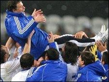 The Greeks celebrate by hoisting coach Otto Rehhagel aloft
