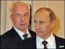 Mykola Azarov (left) and Vladimir Putin