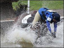 Kristina Cook of Great Britain falls on day three of the Badminton Horse Trials on May 2, 2010 in Badminton