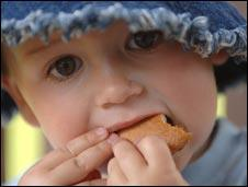 Toddler eating biscuit