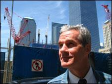 Mike Burke stands by cranes at Ground Zero