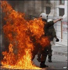 Policeman hit by petrol bomb