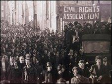 Civil rights campaigners march through Londonderry on Bloody Sunday