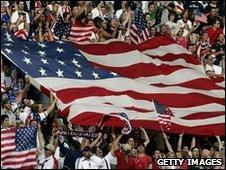 US football supporters wave flags