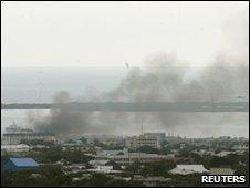 Smoke rises over Kingston's Tivoli Gardens community, 24 May