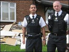 Officers outside house
