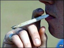 A man smoking cannabis cigarette